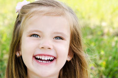 Cute smiling little girl on the meadow Royalty Free Stock Photo