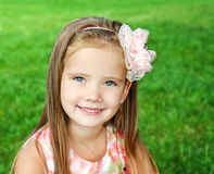 Cute smiling little girl on the meadow Stock Photos