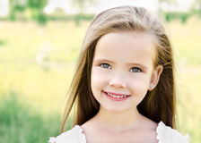 Cute smiling little girl on the meadow Stock Image