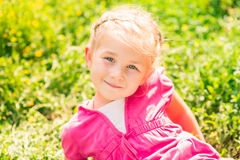 Cute smiling little girl on the meadow Royalty Free Stock Image