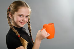 Cute smiling little girl with a mug Royalty Free Stock Photography