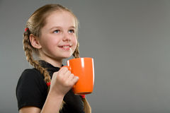 Cute smiling little girl with a mug Royalty Free Stock Photos