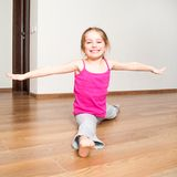 Little girl engaged in fitness Stock Images