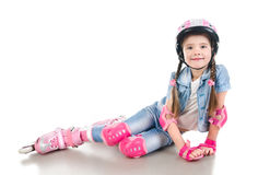 Cute smiling little girl in pink roller skates Stock Photography