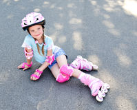 Cute smiling little girl in pink roller skates Stock Images