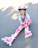 Cute smiling little girl in pink roller skates Royalty Free Stock Photos