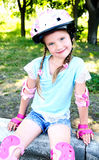 Cute smiling little girl in pink roller skates Royalty Free Stock Image