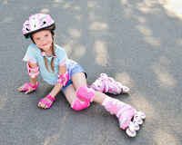 Cute smiling little girl in pink roller skates Royalty Free Stock Images