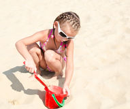Cute smiling little girl playing on beach Royalty Free Stock Photography