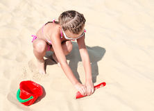 Cute smiling little girl playing on beach Stock Photography