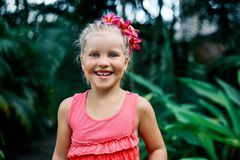 Cute smiling little girl portrait on summer day in the street. Happy children, childhood concept royalty free stock images