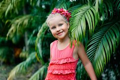 Cute smiling little girl portrait on summer day in the street. Happy children, childhood concept royalty free stock photo