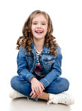 Cute smiling little girl sitting on the floor Stock Photo
