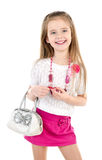 Cute smiling little girl in skirt wiht bag and beads Royalty Free Stock Photography