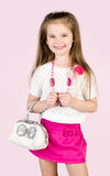 Cute smiling little girl in skirt wiht bag and beads Stock Photography