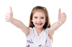 Cute smiling little girl with two fingers up. Isolated on a white Royalty Free Stock Photography