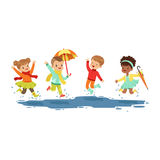 Cute smiling little kids jumping and splashing through the puddles, boys and girls playing in the rain cartoon vector Stock Images