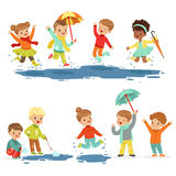 Cute smiling little kids playing on puddles, set for label design. Active leisure for children. Cartoon detailed royalty free illustration
