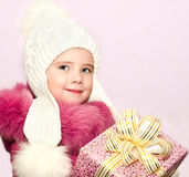 Cute smiling little little girl with present Stock Image