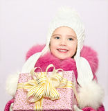 Cute smiling little little girl with present Stock Photo