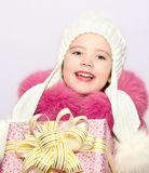 Cute smiling little little girl with present in christmas time Royalty Free Stock Images