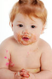 Cute smiling messy baby Stock Photography