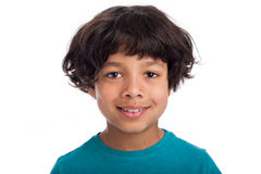 Cute Smiling Mixed Rasce Boy. Cute casual mixed race afro caribbean boy standing isolated in studio white background Royalty Free Stock Photo