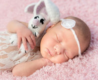 Cute smiling newborn baby sleeps on blanket Royalty Free Stock Photography