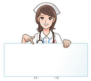 A Cute smiling nurse pointing to a blank board Stock Photography