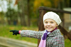Cute smiling pretty little girl with lifted arm Royalty Free Stock Images