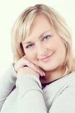 Cute smiling relaxing plump woman Stock Image