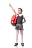 Cute smiling schoolgirl in uniform standing on Stock Photos