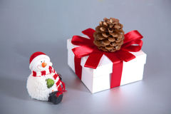 Cute smiling snowman brought a Christmas gift Royalty Free Stock Image