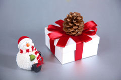 Cute smiling snowman brought a Christmas gift Stock Image