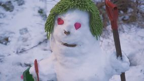 The cute smiling snowman with eyes heart for Valentine`s Day. Hd stock video