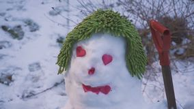 The cute smiling snowman with eyes heart for Valentine`s Day. Hd stock video footage