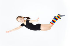 Cute smiling teen schoolgirl flying on white background Royalty Free Stock Image