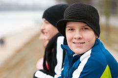 Cute smiling teenage boy outside with friends stock images
