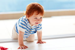 Cute smiling toddler baby crawling on the floor Royalty Free Stock Photos