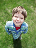 Cute smiling toddler in summer garden Stock Images