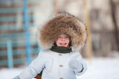 Cute smiling toddler in winter jacket Stock Photos