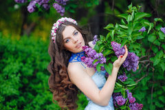 Cute smiling woman outdoors in spring garden Royalty Free Stock Images
