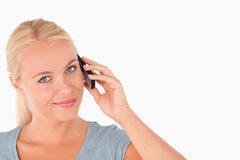 Cute smiling woman on the phone Stock Images