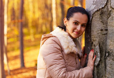 Cute smiling woman posing in nature Stock Photo