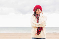 Cute smiling woman in stylish warm clothing at beach Royalty Free Stock Photography