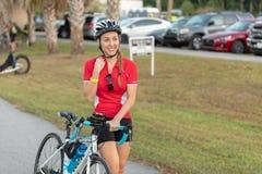 Cute, smiling woman walking her bike. royalty free stock photo