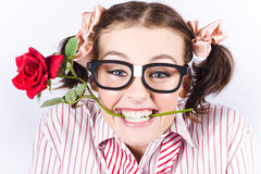 Cute Smiling Woman Wearing Nerd Glasses With Rose stock photography