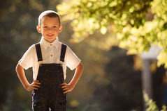 Cute smiling young boy backlit by the sun Stock Photos