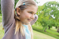 Cute smiling young girl at park Stock Photography