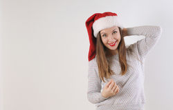 Cute smiling young woman in santa hat on white background Royalty Free Stock Image